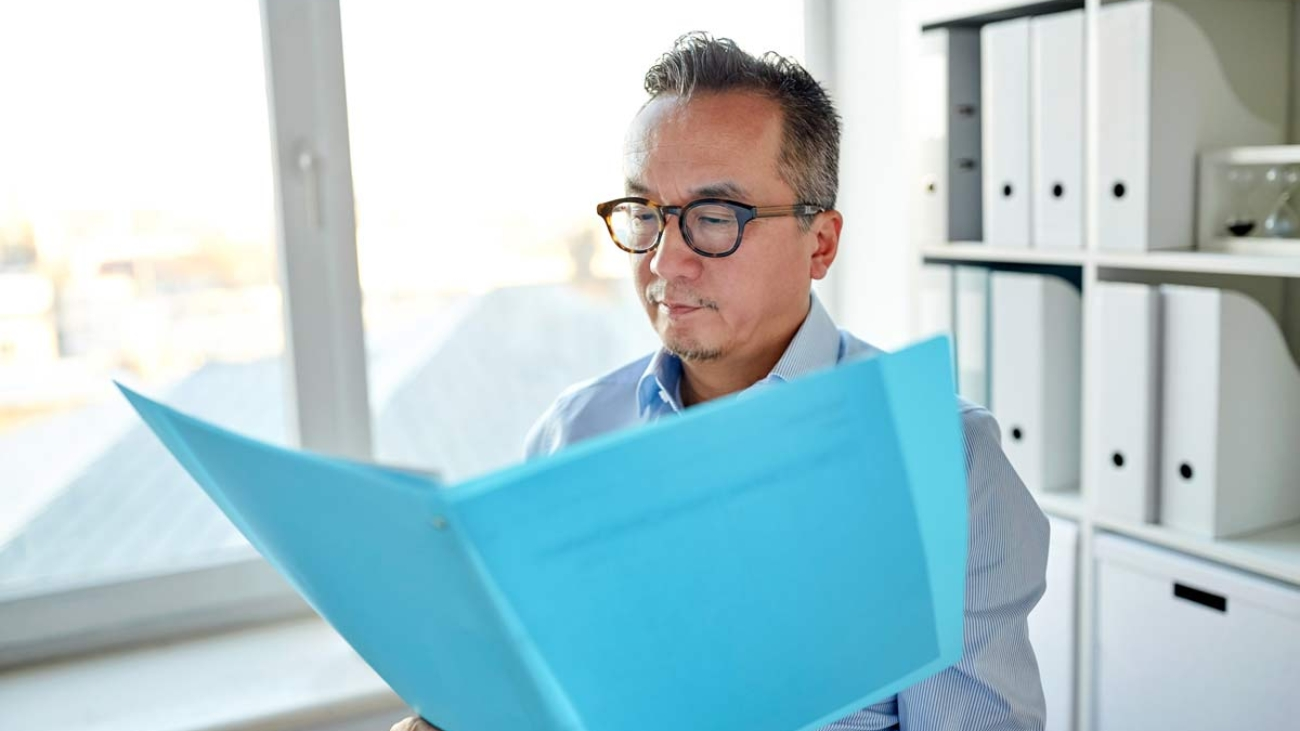 Business owner looks at certification