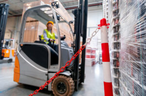 Worker uses forklift